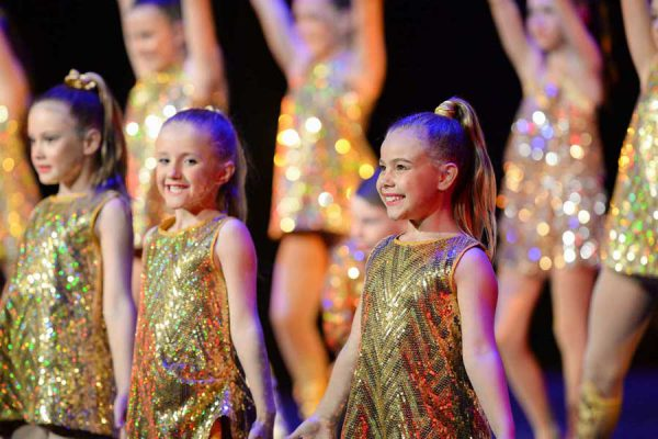 students on stage at dance concert
