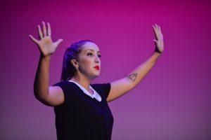 Miss Reegan performing on stage