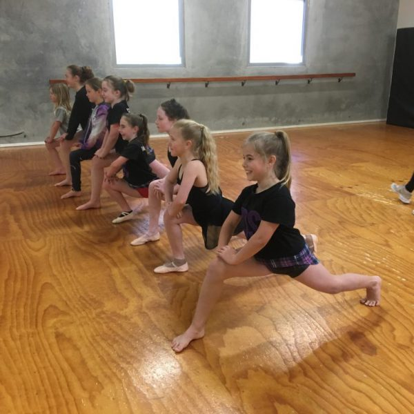Stretching safely at the start of any dance class is so important!